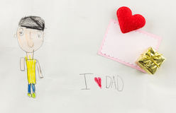 Amo al papá - el niño escribe la tarjeta Foto de archivo libre de regalías