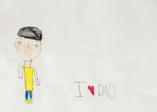 Amo al papá - el niño escribe la tarjeta Foto de archivo