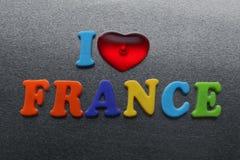 Amo Francia explicada usando los imanes coloreados del refrigerador Imagenes de archivo