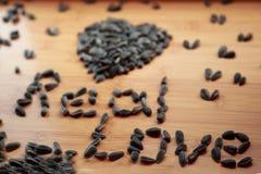 Amo i semi di girasole immagini stock libere da diritti