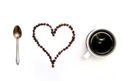 Amo il caffè Forme fatte dai chicchi di caffè Immagine Stock