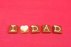 Amo il cioccolato del papà Immagine Stock