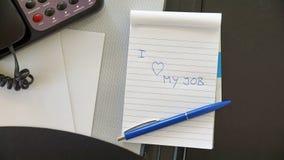 Amo mi trabajo escrito imagen de archivo libre de regalías