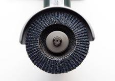 Amoladora con el disco de la solapa Foto de archivo