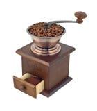 Amoladora de café con las habas y el recorte de tierra Foto de archivo