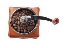 Amoladora de café con los granos de café Fotografía de archivo