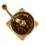 Amoladora de café con los granos de café Imagenes de archivo
