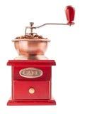Amoladora de café con los granos de café aislados en el fondo blanco Imagenes de archivo