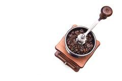 Amoladora de café en un fondo blanco Fotos de archivo libres de regalías