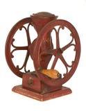 Amoladora de café tablero de la rueda del hierro rojo antiguo Foto de archivo libre de regalías