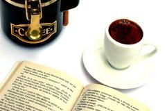 Amoladora, taza y libro imagenes de archivo