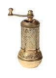 Amoladora turca vieja del metal en el fondo blanco, aislado Fotografía de archivo libre de regalías