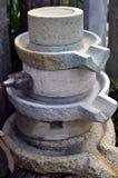 Amoladora vieja de la piedra del arroz Imagen de archivo