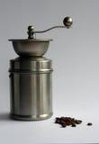 Amoladora y habas de café del acero inoxidable Imagen de archivo libre de regalías