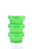 Amontonamiento de la taza plástica verde Foto de archivo