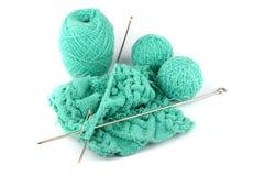 Amorçages de bleu pour le tricotage et un rai Photo stock