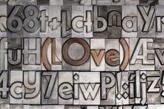 Amor con el tipo movible impresión Foto de archivo