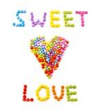 Amor da inscrição dos doces de chocolate coloridos Imagem de Stock