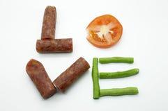 Amor da mensagem do alimento Imagem de Stock Royalty Free