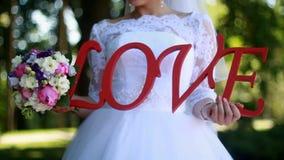 Amor de la inscripción en la boda metrajes