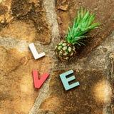 Amor de la palabra en el piso de piedra Fotografía de archivo