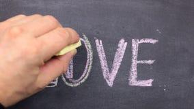 Amor de la palabra, escrito con tiza en la pizarra almacen de metraje de vídeo