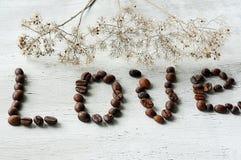 Amor de los granos de café de la inscripción Fotografía de archivo