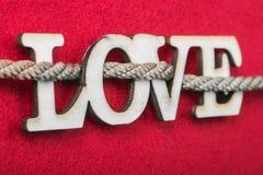 Amor de madera tallado de las letras Foto de archivo libre de regalías