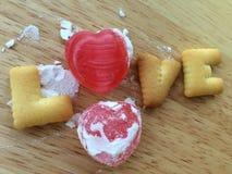 Amor del caramelo de la tarjeta del día de San Valentín Fotos de archivo