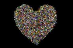 Amor en forma de corazón de granos en fondo negro Fotografía de archivo