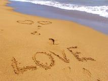 Amor en la arena Foto de archivo libre de regalías