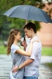 Amor en la lluvia Imágenes de archivo libres de regalías