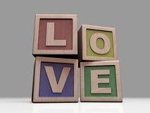 AMOR escrito com blocos de madeira Foto de Stock