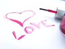 Amor escrito con el pulimento de clavo Imagen de archivo