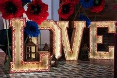 Amor grande das letras no estúdio Fotos de Stock Royalty Free