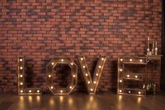 AMOR iluminado de madera grande de las letras Fotografía de archivo libre de regalías