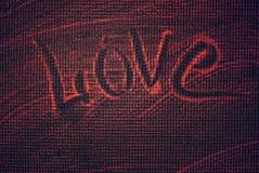 Amor, a inscrição na espuma Uma declaração do amor foto de stock