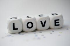 Amor, letras de los dados Imagen de archivo libre de regalías