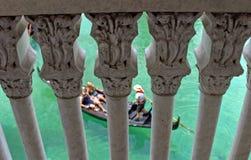 Amor ... Love. A couple takes a romantic gondola ride. As seen through pillars royalty free stock photo
