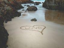 Amor na praia Imagem de Stock