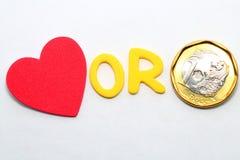 Amor o dinero Foto de archivo