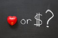 ¿Amor o dólares? Imágenes de archivo libres de regalías