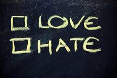 Amor ou ódio? imagem de stock