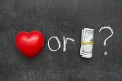 Amor ou dinheiro Fotografia de Stock Royalty Free