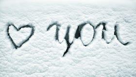 Amor que nevado você assina no fundo da janela Fotografia de Stock Royalty Free