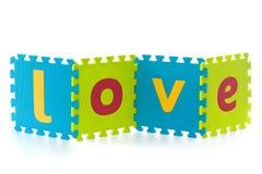 Amor - sinal com letras do enigma do alfabeto Imagens de Stock