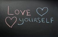 Amor usted mismo de la inscripción Fotografía de archivo libre de regalías