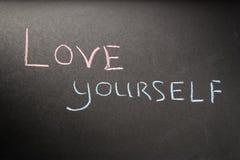 Amor usted mismo de la inscripción Imágenes de archivo libres de regalías