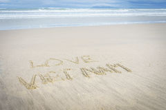 Amor Vietnam escrito en arena Imagenes de archivo