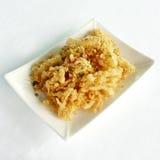 Amorce blanche cuite à la friteuse avec du sel épicé Image stock